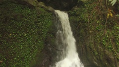 Jungle Waterfall and Swimming Hole Close UP Jib Down Water Cascading Stock Footage