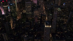 AERIAL: Midtown Manhattan, Times Square and Rockefeller Plaza lit at night Stock Footage