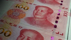 China Yuan banknotes emerging from the money press Stock Footage