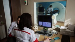 Mid adult nurse preparing patient for CT scan test in hospital Stock Footage