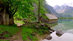 Beautiful mountain lake Obersee with old wooden cottage, Alps, Germany Stock Footage