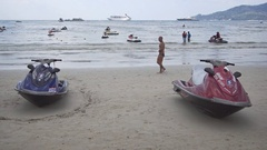 Pair of Personal Watercraft for Rent, Beached on the Sand at Patong Beach Stock Footage