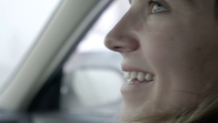 Closeup Of Young Woman Sitting In Passenger Seat, Looks Out Window, Smiles Stock Footage