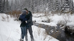 Couple Snowshoe, Stop And Kiss, Woman Playfully Pushes Boyfriend, He Throws Snow Stock Footage