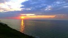 Sunset over the Baltic sea with sunbeam and clouds in summer Stock Footage