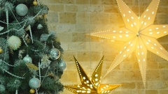Christmas tree with toys and two stars shine in the background Stock Footage