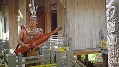 Man Performs Folk Music on Wooden Sapeh at Taman Nusa Cultural Park Stock Footage
