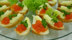Sandwich with red caviar on white bread. Festive Christmas table with Stock Footage
