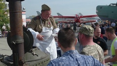 Military Field Kitchen Serving Food to Attendees of Car show and Air Fair Stock Footage