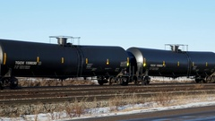 Train tank cars moving along on railway Stock Footage
