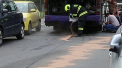 Failure of the bus on a road, drivers repairing a tube. Stock Footage