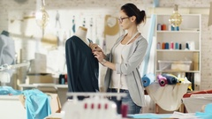 Beautiful Woman Fashion Designer Working with Tailoring Mannequin Stock Footage