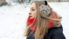 Irritated girl waiting for someone in the park at wintry day, steadycam shot Stock Footage