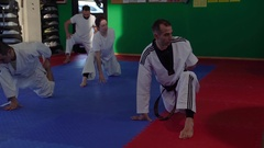 1058 Adult taekwondo training session in the gym, stretching, selective foc.. Stock Footage