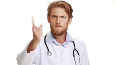 Serious male Caucasian doctor scolding and waving hand at camera on white Stock Footage