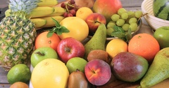 Dolly view of an assortment of fresh, healthy, organic fruits Stock Footage