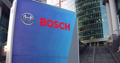 Street signage board with Robert Bosch GmbH logo. Modern office center Stock Footage