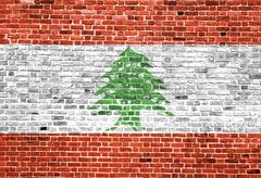Flag of Lebanon painted on brick wall, background texture Stock Photos
