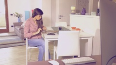 Woman at home working with tablet dolly shot retro style Stock Footage