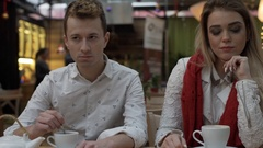 Offended couple sitting in silence in the cafe, steadycam shot Arkistovideo