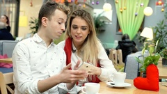 Boy asks his girlfriend about something and look irritated Stock Footage