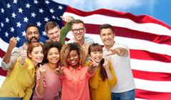 International people gesturing over american flag Stock Photos