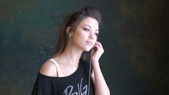 Young beautiful girl listening to music through headphones Stock Footage