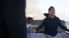 4K Personal trainer timing a man skipping with a jump rope Stock Footage