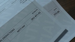 Payslip inequality pan view 3 EX Stock Footage
