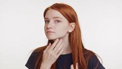 Young charming ginger teenage girl wearing dark blue t-shirt touching combing Stock Footage