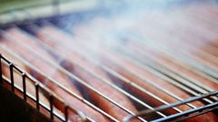 Bratwurst sausages cooking on a grill barbecue Stock Footage