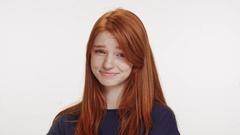 Not-impressed cute foxy Caucasian teenage girl wearing dark blue t-shirt lokking Stock Footage