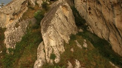 The drone runs along the crest of a rocky mountain. AERIAL About karst, rock Stock Footage