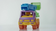 Plastic toy truck at white background Stock Footage