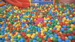 Happy Little Kid Girl Playing at Colorful Plastic Balls Playground High Vie.. Stock Footage