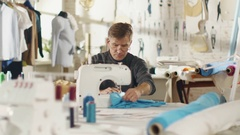 Male Fashion Designer/ Dressmaker Working on a Sewing Machine Stock Footage