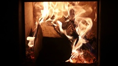 Fire shrouded the birch logs in the stove, slow motion Stock Footage