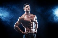 Strong bodybuilder man with perfect abs, shoulders,biceps, triceps, chest Stock Photos