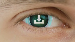Close-up of eye with computer text overlayed. Zoom in centr. sign download Stock Footage