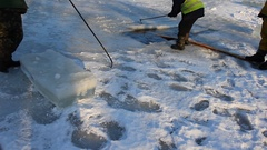 Blocks of ice are cut on an ice field and moved Stock Footage
