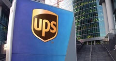 Street signage board with United Parcel Service UPS logo. Modern office center Stock Footage