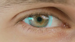 Close-up of eye with computer data and text overlayed. Zoom in centr. charts Stock Footage