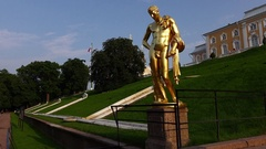 Golden sculpture at terrace stairs, Petergof lower gardens at main Cascade Stock Footage