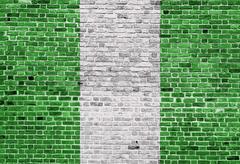 Flag of Nigeria painted on brick wall, background texture Kuvituskuvat