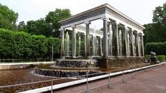 Tourist girl walk forward and take photo of gorgeous fountain building Stock Footage