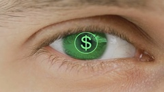 Closeup of eye with computer text overlayed. Zoom in centr. sign global currency Stock Footage