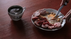 Eating omelette with sausages. Stock Footage