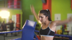 Young woman training pre-match warm-up in the boxing ring Stock Footage
