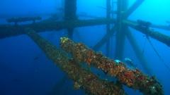 Looking down legs of oil platform Stock Footage