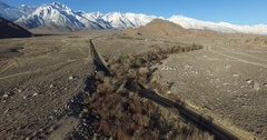 A beautiful aerial view of the Sierra Nevada mountains over a California highway Stock Footage